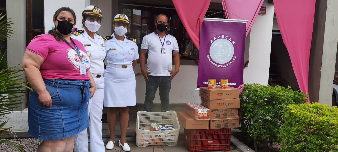 Representantes do NAS e da AAPECAN na doação.jpg